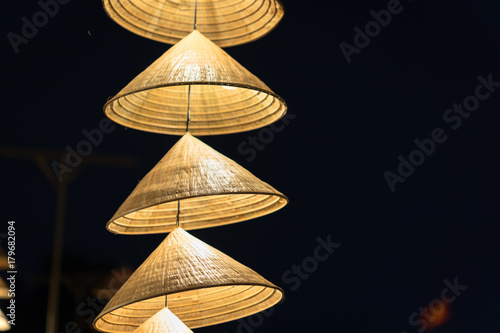 Foto  Vietnamese traditional conical hats hanging on wire for decoration