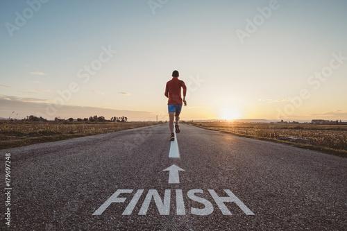 Valokuva  Man running to finish