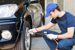 Mechanic inflating a tire