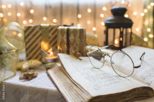 Holy bible book with eyeglasses