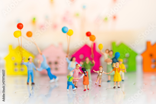 Fotografie, Obraz  Miniature family using as background International day of families concept