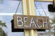 Beach sign in window
