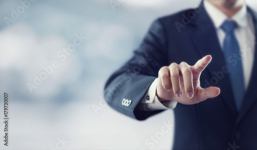 Fotografija  Businessman hand touching virtual screen, modern background concept , can put yo