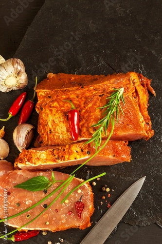 Fototapety, obrazy: Raw pork chops with spices. Sliced meat prepared on the grill.