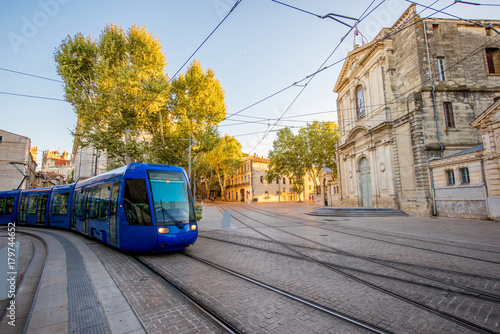 Obraz Street view with Saint-Charles chapel and tram during the sunset in Montpellier city in southern France - fototapety do salonu