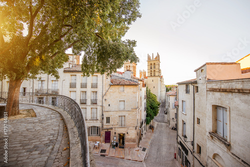 Street view with saint Pierre cathedral at the old town of Montpellier city in Occitanie region of France