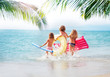 Three girls running in the sea at tropical beach
