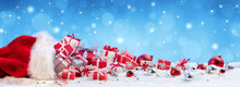 Red Bag With Christmas Present On Snow