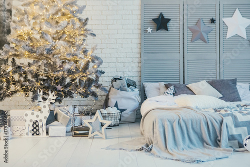 Poster Chicken Winter holidays decorated bedroom interior. Christmas and New Year mood stars end tree
