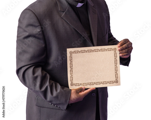 Fotomural Clergyman holding certificate isolated on white background