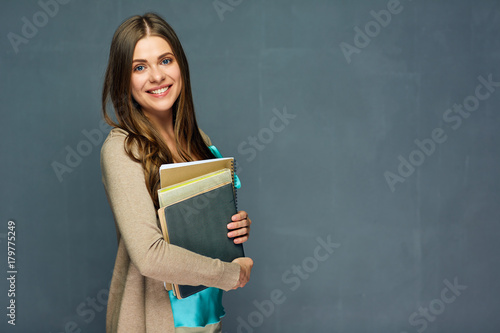 Fotomural Smiling girl student or woman teacher portrait