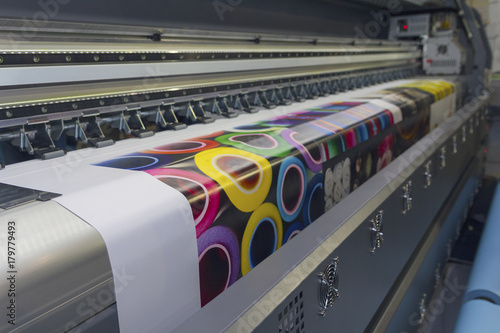 Fotografie, Obraz  Large format printing machine in operation. Industry