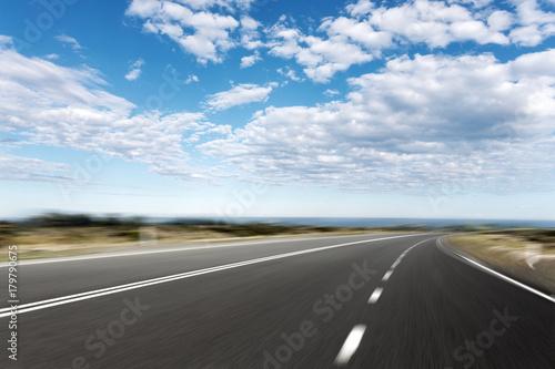 Foto op Aluminium Luchthaven empty asphalt road with blue sea in blue sky