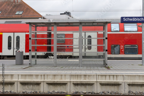 Foto op Aluminium Luchthaven trainstation with train passing by and rails with infrastructure beside