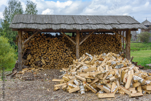 Fotobehang Brandhout textuur Pile of birch firewood outdoors in summer