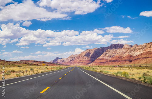 Poster Route 66 Picturesque road in Arizona. red stone cliffs and blue sky