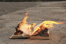 Book With Burning Pages On A C...