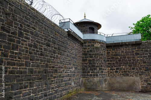 Fotografie, Obraz  Bluestone prison walls at J Ward in Ararat, Australia