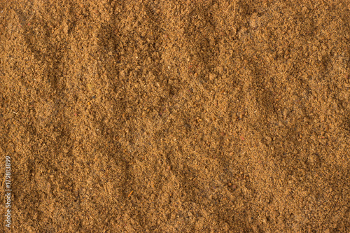 Foto  ground nutmeg powder spice as a background, natural seasoning texture