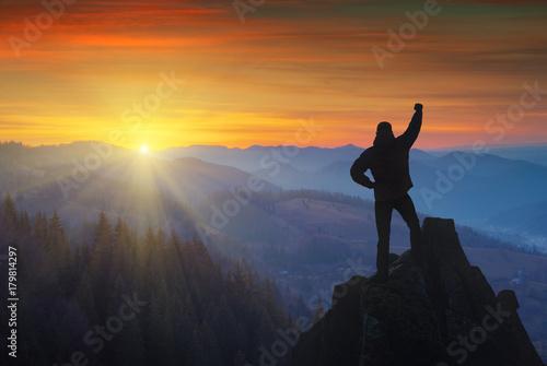 Valokuvatapetti The successful man standing on a mountain top