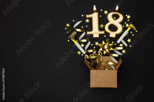 Photographie  Number 18 gold celebration candle and gift box background