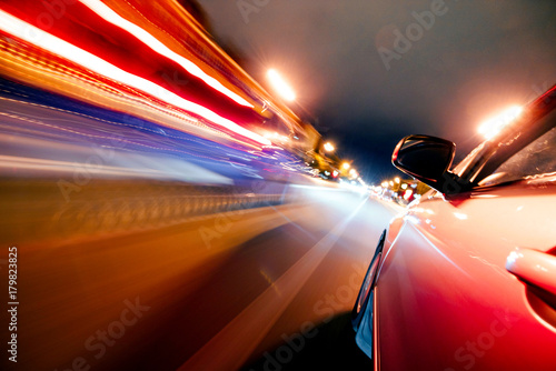 Photo  Car on the road with motion blur background.