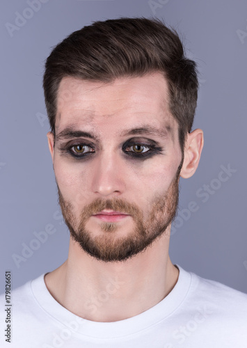 Dirty Makeup Brushes: Vertical Portrait Of A Young Man With Dirty Makeup. Sad