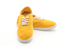 Yellow Sneakers On White Backg...
