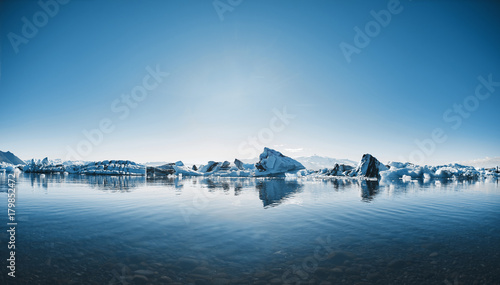 Beatufil vibrant picture of icelandic glacier and glacier lagoon with water and Wallpaper Mural