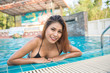 Portrait of asian girl tan side swimming pool