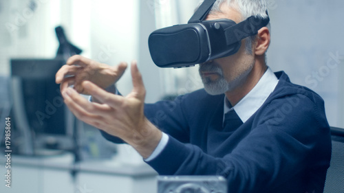 Fototapety, obrazy: IT Engineer Working with Virtual Reality Headset On. He Works in His Modern and Minimalistic Office. VR helmet.