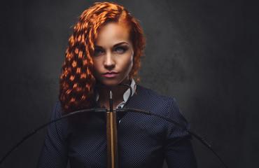 Redhead female  holds cross...