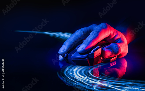 Photo  Professional wireless Game Mouse on dark background with techno light as line of