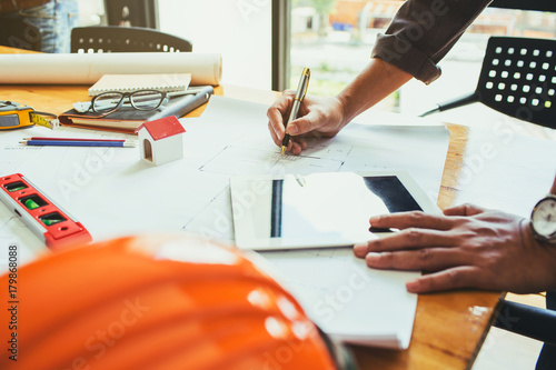 Engineer business man hardworking to drawing architect blueprint startup small business for new workplace of his customer for good and strong building design Wallpaper Mural