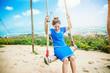 Asian women travel sleep relax.Women wear dresses. Living Swing. Thailand