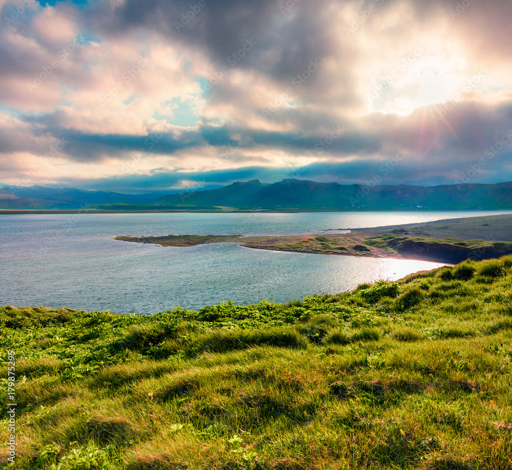 Fototapeta Typical Icelandic landscape with volcanic mountains and Atlantic ocean coast.