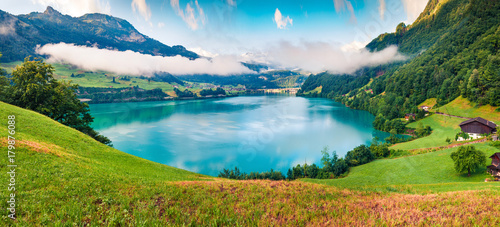 Foto auf AluDibond Himmelblau Foggy summer panorama of Lungerersee lake. Colorful morning view of Swiss Alps, Lungern village location, Switzerland, Europe. Artistic style post processed photo.