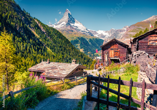 Sunny summer morning in Zermatt village with Matterhorn (Monte Cervino, Mont Cervin) peak on backgroud Wallpaper Mural