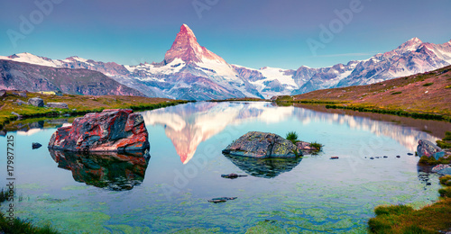 Colorful summer panorama of the Stellisee lake. Few minutes before sunrise. #179877215