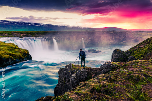 Montage in der Fensternische Aubergine lila Summer morning scene on the Godafoss Waterfall with photographer. Colorful sunrise on the on Skjalfandafljot river, Iceland, Europe. Artistic style post processed photo.