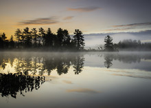 A Peaceful Beginning To A New Day On A Secluded Lake In The North Woods Of Northern Wisconsin.