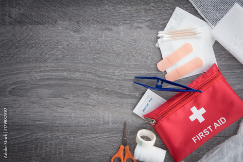 First aid medical kit on wood background,copy space,top view Fototapet