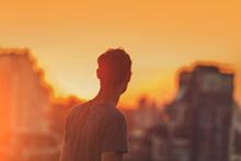 Man On The Sunset Background.