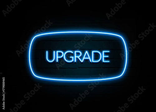 Fotografering  Upgrade  - colorful Neon Sign on brickwall