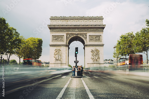 Valokuva  Famous avenue Champs-Elysees and the Triumphal Arch, symbol of the glory and historical heritage