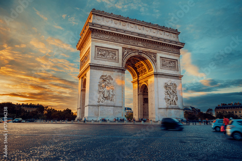 Valokuva  Famous Paris avenue Champs-Elysees and the Triumphal Arch, symbol of the glory on bright sunny day with cloudy sky