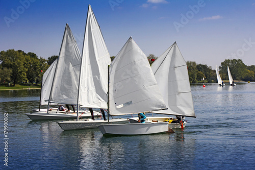 Voile Sports sailing in Lots of Small white boats on the lake