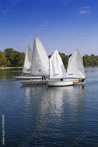 Staande foto Zeilen Sports sailing in Lots of Small white boats on the lake