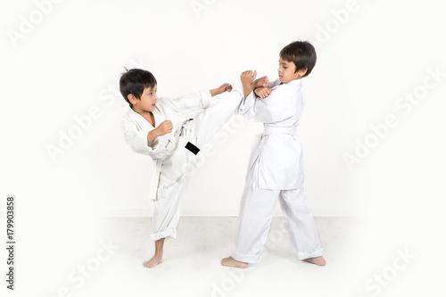 Garden Poster Martial arts two boys of the karateka in a white kimono battle or train