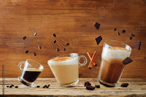 Slika na platnu Different types of coffee with flying ingredients